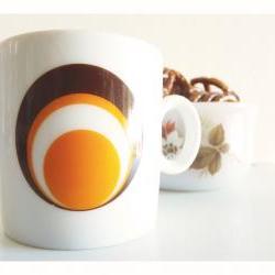 1970's espresso cup. Brown, orange, white circles.